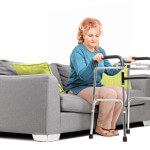 Woman standing up from a sofa with walker