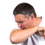 Man Coughing Inside Elbow